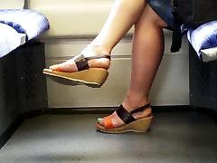 mature feet with blue toenails in train
