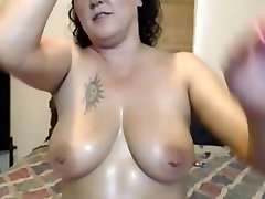 Sexy Milf Teases her Pussy and Squirts