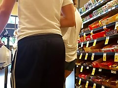 Candid cheeks in little shorts in line