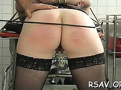 Muffled asian cutie gets her bumpers pinched bdsm style