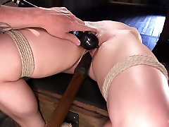 Tied up babe Dahlia Sky is punished and fucked in the dark mom stepcock room