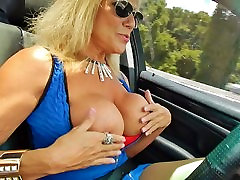 Slut flashing big tits while driving