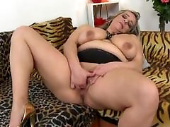 FAT OLD CHICK PLAYS WITH HER TITS AND PUSSY