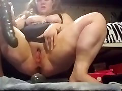 BBW stretching her pussy and asshole with huge double dildo