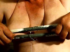 pulling hard on my clamped nipples to stretch my tits