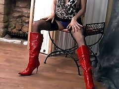 Kinky brunette Milf teases tits nylons panties leather boots