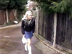 Hot blonde upskirt in black panties peeing in public street