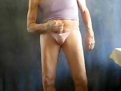 Sissy bitch masturbates in pink panties, squirts.