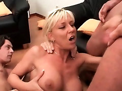 Alluring mature slut takes cocks in all her holes