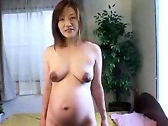 Asian milf flashing her preggo body