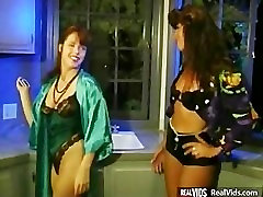 Two horny lesbians fucks on kitchen
