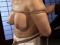 Mature bitch gets roped up and hung in a cum in sex movie session