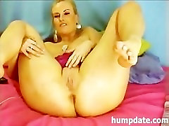Busty milf dildoing her asshole