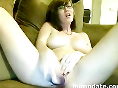 Stunning babe with big tits toying pussy .