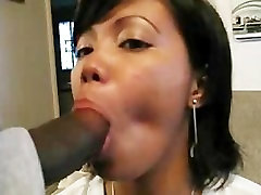 CUTE SUBMISSIVE ASIAN GIRL SUCKS BBC