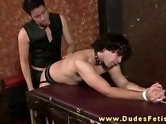 Dominant gay master spanking his subs ass