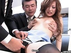 Japanese brunette sucks two fat dicks