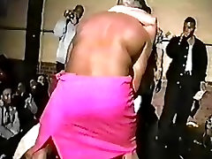 Girl on stage sucking male strippers dick
