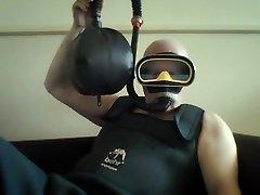 vintage mask and snorkel rebreathe in wadersuit