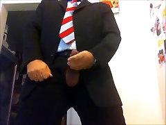 cumming in suit and tie