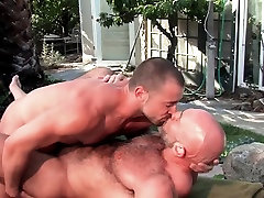 Showering muscled gay cum