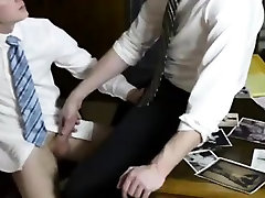 Young straight guy sucking big gay cock in office