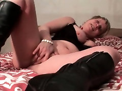 Chesty mature in lace rubs shaved horny cunt