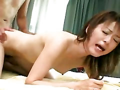 Asian babe getting fucked doggy style like a nut