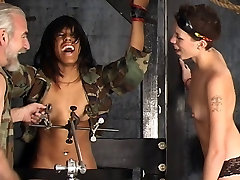 Two sexy dominatrix girls punish a hot ebony lesbian slut