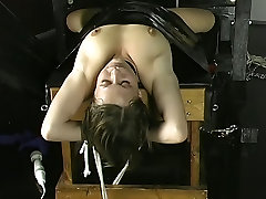 Young brunette is wrapped in black garbage bag and fucked in dungeon