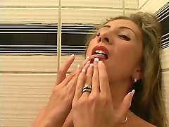 Gorgeous blonde fingers her juicy shaved pussy and uses toy in shower