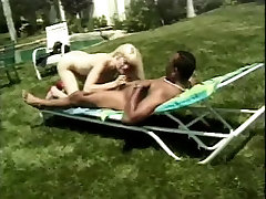 Gorgeous blonde loves huge black dick in her ass from behind outdoors