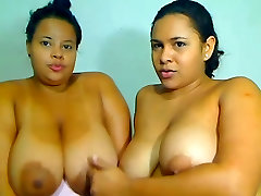 Latin BBW Lesbian kiss each other and play with big boobs