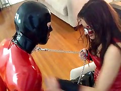 Mistress & slave rubber playing